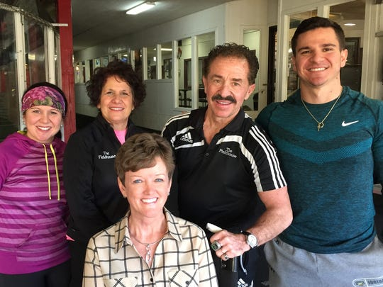 The Fieldhouse family, Alainna (Amicone) Durfee, Harriet Amicone, Mick Amicone and Matt Amicone were happy to help Director Theressa Snyder, front, equip the PBHS fitness center by donating several pieces of exercise equipment.