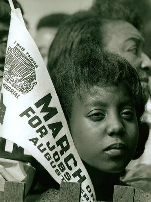 A 12 year-old  Edith Lee-Payne of Detroit, looks on at the March on Washington on Aug. 28, 1963. Her mother Dorothy Elizabeth Lee is standing behind her.