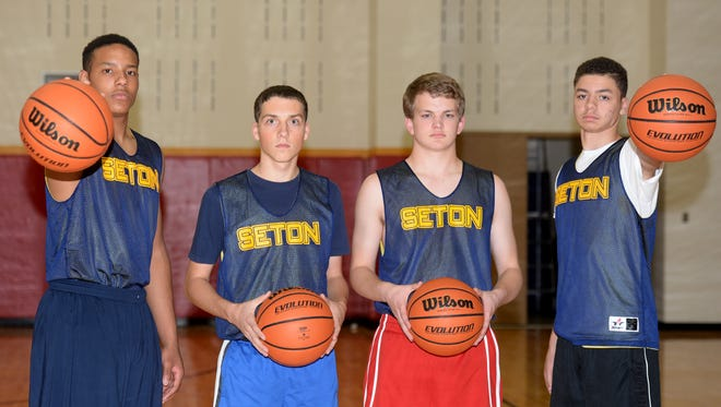 Seton Catholic High School boys basketball players Desmond Bane, left, Colten Pipenger, Cliff Dickman and Billie Webster III at practice Tuesday, Nov. 17, 2015 in Richmond.