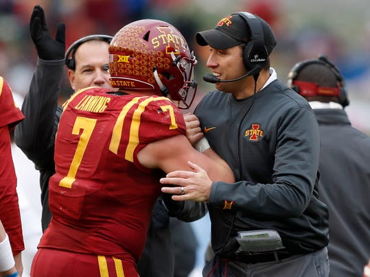 Iowa State quarterback Joel Lanning (7) celebrates with head coach Matt Campbell, right, after scoring on a 1-yard touchdown run during the first half of an NCAA college football game against Oklahoma State, Saturday, Nov. 11, 2017, in Ames, Iowa. (AP Photo/Charlie Neibergall)