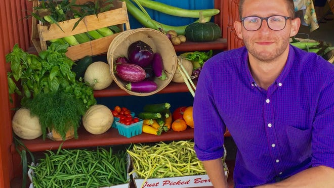 Oliver Gubenko poses with farm-fresh produce from DeWolf Farm in New Egypt that his firm, Harvest Drop, aggregates for weekly delivery to restaurant customers.