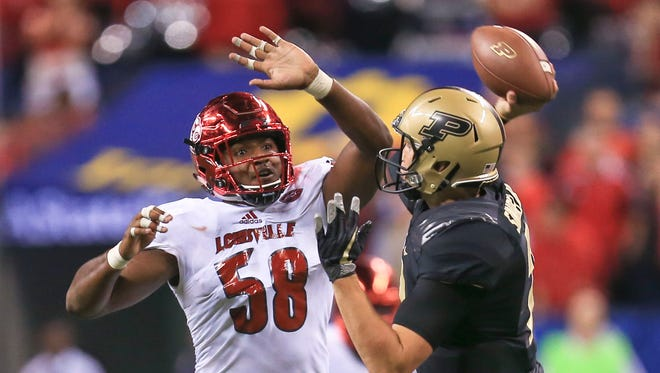 Louisville's Jonathan Greenard pressures Purdue quarterback Elijah Sindelar at Lucas Oil Field Sept. 2 in Indianapolis.