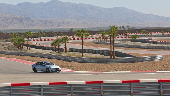 A BMW driver enters the new 4.5 miles of test track at the new Thermal Club in near Ave 62 and Polk St. in Thermal, Friday, October 3, 2014.