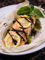 Chef Robin Miller created this pouch-cooked salmon with basil, balsamic glaze and lemon to celebrate National Lemonade Day.