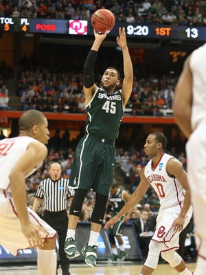 Michigan State's Denzel Valentine shoots against Oklahoma during the first half of the NCAA East Regional semifinals on Friday, March 27,2015 at Carrier Dome in Syracuse N.Y.