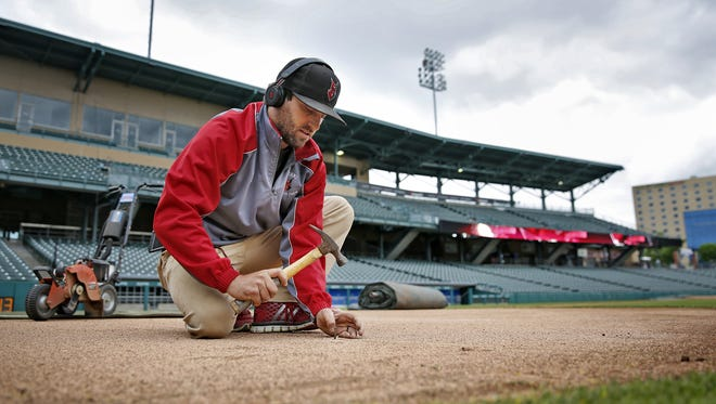 Victory Field Head Groundskeeper Joey Stevenson lays down a line to act as a guide while he does edging on the grass around the field at Victory Field, Monday, May 1, 2017.  The next game at the Indianapolis Indians home field is Tuesday, May 2, 2017.