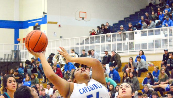 Carlsbad's Kaliah Montoya puts up a shot in the first quarter on Friday.