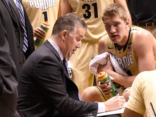 Purdue Boilermakers head coach Matt Painter draws up a play a  center Isaac Haas (44) watches intently in the 2nd half at Mackey Arena.