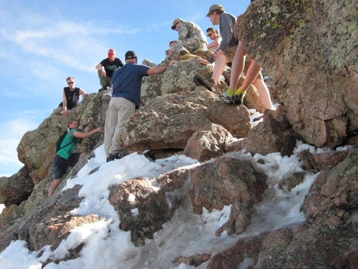 Colorado State University ROTC cadets and hikers help get a 20-year-old man to safety last Sunday after he became stranded on Horsetooth Mountain in the foothills west of Fort Collins.
