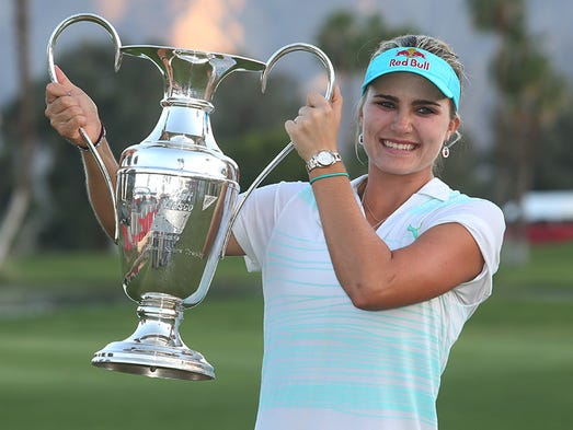 2014 Kraft Nabisco Championship winner Lexi Thompson holds the trophy following the final round of the Kraft Nabisco Championship at Mission Hills Country Club in Rancho Mirage, CA, Sunday April 6, 2014.