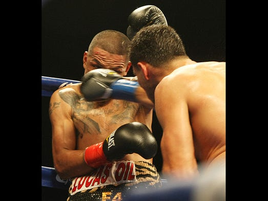 """Aron """" El Asesino"""" Martinez takes the punch from Josesito """"The RIverside Rocky"""" Lopez that stopped their fight in the fifth round by TKO in their 10 round Welterweight bout at The Show in Rancho Mirage Thursday, April 24, 2014."""