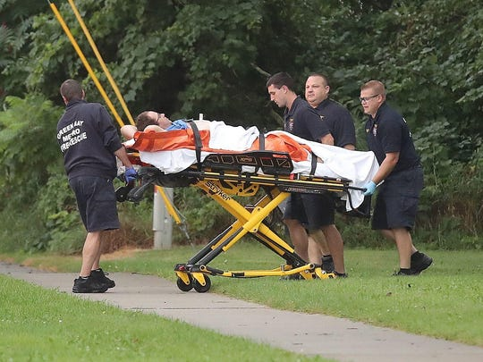 Green Bay Metro Fire and Rescue remove a man on a gurney from the scene of a stabbing in the 2700 block of Humboldt Road in Green Bay on Thursday.
