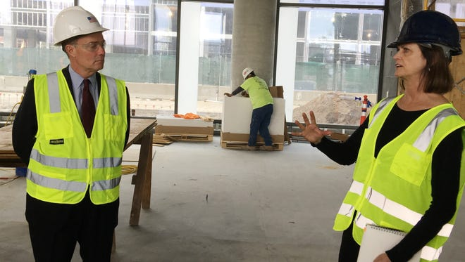 Architect Deborah Berke (right) discusses the design of the new Cummins distribution headquarters in Downtown Indianapolis as Mayor Joe Hogsett looks on. The building is scheduled to be completed in January.