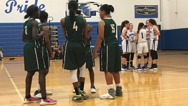 Woodlands and Dobbs Ferry players gather with one another during a game on Jan. 19, 2017.