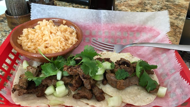 The carne asada tacos with cilantro and cucumber bits are filling and tasty. The rice is hot and puffy.