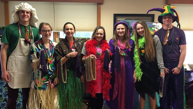 Earlier this month, members of the MHHS National Honor Society volunteered at Good Samaritan Village for their Mardi Gras parade. Students helped to pass out beads and steer the floats through the hallways of the facility.