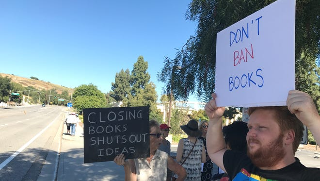 Richard Ryder, right, of Calabasas, protests what he believes is book banning on the part of Conejo Valley Unified School District  Trustee Mike Dunn.