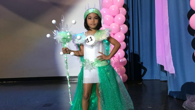 Felicia Cruz shows off her costume made of recycled materials at the first Little Miss Guam pageant on Aug. 27, 2017.