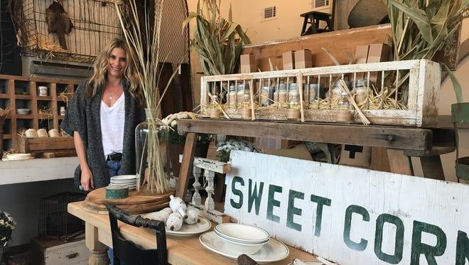 Kristi Delfino owns Loot Home & Garden in Wisconsin Rapids.