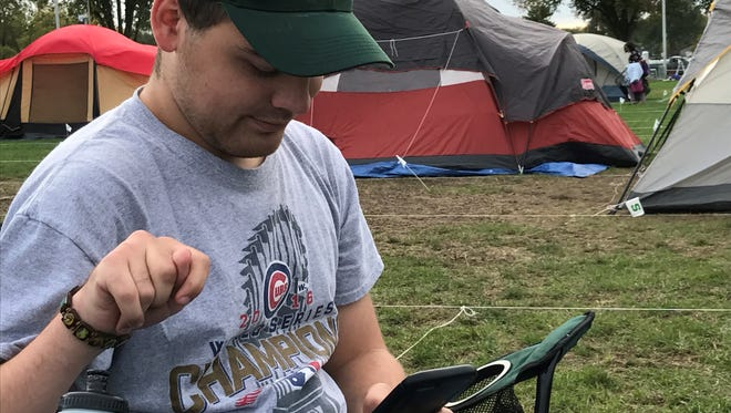Sitting in camping space No. 367, Thomas Adams of Bridgman, patiently awaits Tom Izzo and the Spartans arrival at the annual Izzone Campout Oct. 13, in East Lansing.