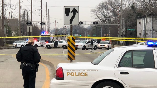 Indianapolis police investigate after a pursuit and police involved shooting Sunday morning on Raymond Street