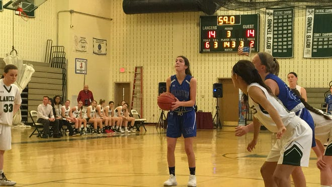 Millburn's Abigail Policarpio shoots a free throw at the end of the third quarter to give the Millers its first lead of the game.