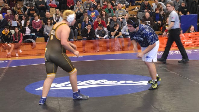 Millburn senior Anthony Pace (right) finished third at heavyweight in District 16.