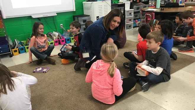 Michelle Loewenhagen,talks to second-graders Grace Christensen and Cameron Olson during a writing exercise in her class at Valley View Elementary School in Ashwaubenon.