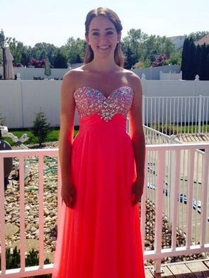 Kelsey Sobieski poses before her senior prom.