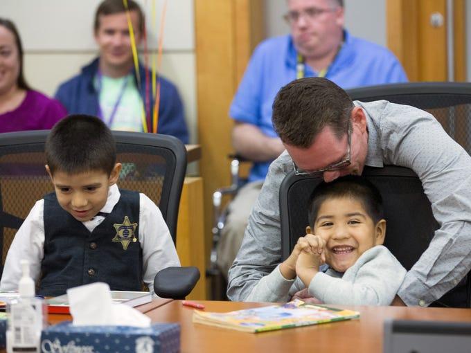 R. Edward Bishop celebrates after adopting  6-year-old