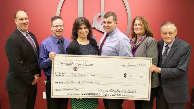 From left to right: Ronald K. Myers, senior vice president and chief financial officer, presents the foundation's $10,000 grant check with Dean Cole to Karen Zobel, Baptist Home CEO and administrator. Also pictured is Baptist Home staff member Brian Zeidan, MaryRose Warcholak, vice president/branch administration & business development and Glenn Sutherland, president and CEO of Ulster Savings Bank.
