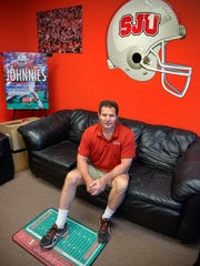 St. John's University head football coach Gary Fasching sits in his office Wednesday, Aug. 10, 2016. He starts a new season without his dad, Joseph, who died several weeks ago. Joseph used to come to all the team's home games, coach Fasching said.