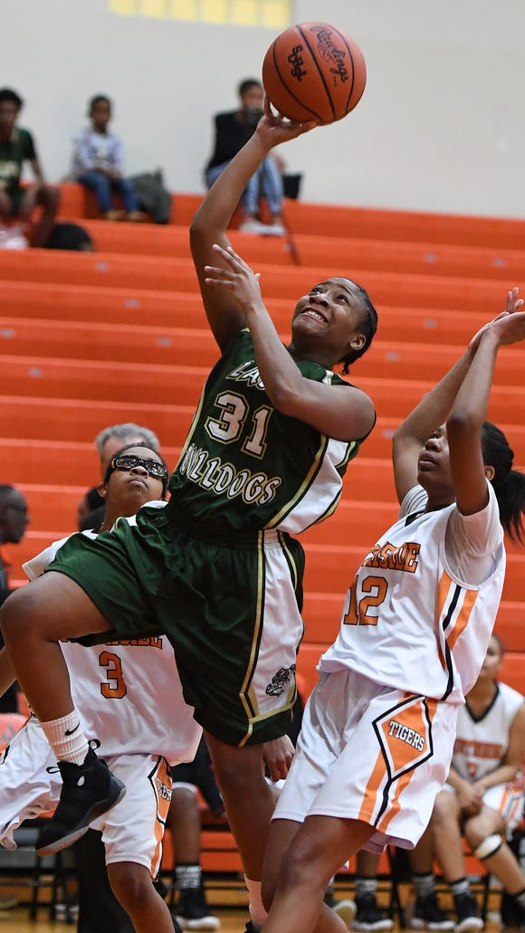 Berea's Tytianna Davis (31) scores past Southside's Anaya Muhammad (3) and Nadira Muhammad (12) during the Bulldogs' 42-35 victory over the host Tigers Friday night.