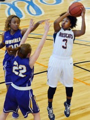 Louisiana College's Neka Jones (3, right) goes for two against Hardin-Simmon's Joanna Daniel (22, front left) and Kayla Brown (30, back left) Saturday, Feb. 7, 2015.