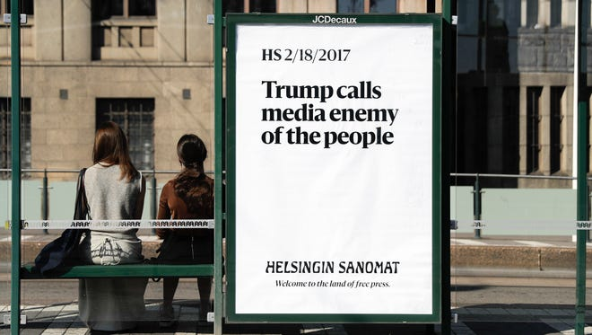 A poster reading 'Trump calls media enemy of the people' is displayed by Finnish newspaper Helsingin Sanomat at a stop for public transport in Helsinki, July 15, 2018.