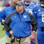 Oct 11, 2014; Lexington, KY, USA; Kentucky Wildcats head coach Mark Stoops coaches his team against the Louisiana-Monroe Warhawks in the second half at Commonwealth Stadium. Kentucky defeated Louisiana-Monroe 48-14. Mandatory Credit: Mark Zerof-USA TODAY Sports