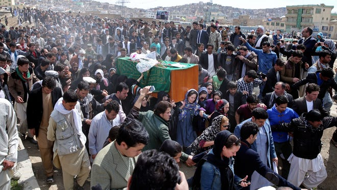 Afghan women-rights activists carry the coffin of 27-year-old Farkhunda, an Afghan woman who was beaten to death by a mob, during her funeral, in Kabul, Afghanistan, Sunday, March 22, 2015. She was killed late Thursday by a mob of mostly men who beat her, set her body on fire and then threw it into the Kabul River, according to police accounts.