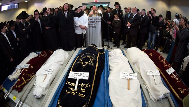 A prayer is said at the close of a March 23 Jerusalem funeral service for the seven children of the Sassoon family who perished in a fire in Brooklyn. The seven siblings, aged 5 to 15, died in a March 21 fire.