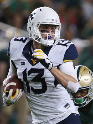 FILE - In this Oct. 21, 2017, file photo, West Virginia wide receiver David Sills V scores against Baylor in the second half of an NCAA college football game in Waco, Texas. Sills was selected to the AP Preseason All-America team, Tuesday, Aug. 21, 2018. (Rod Aydelotte/Waco Tribune-Herald via AP, File)