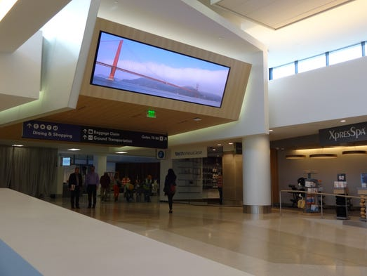 """Fliers enter the San Francisco's new """"T3E"""" gates under this modern-looking entrance area."""