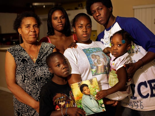 Marie Delly's family, from left, mother Elizanne Delly; son Markinson Telusnord, 8; sister, Bobbi Lene; daughter Jenita Warren, 12; son, Lavanda Warren, 14; and daughter Kenra Dareus, 3. Delly was last seen May 17 leaving her job at Walmart, 3451 U.S. 41 East, near the Collier County government center. Lexey Swall/Staff
