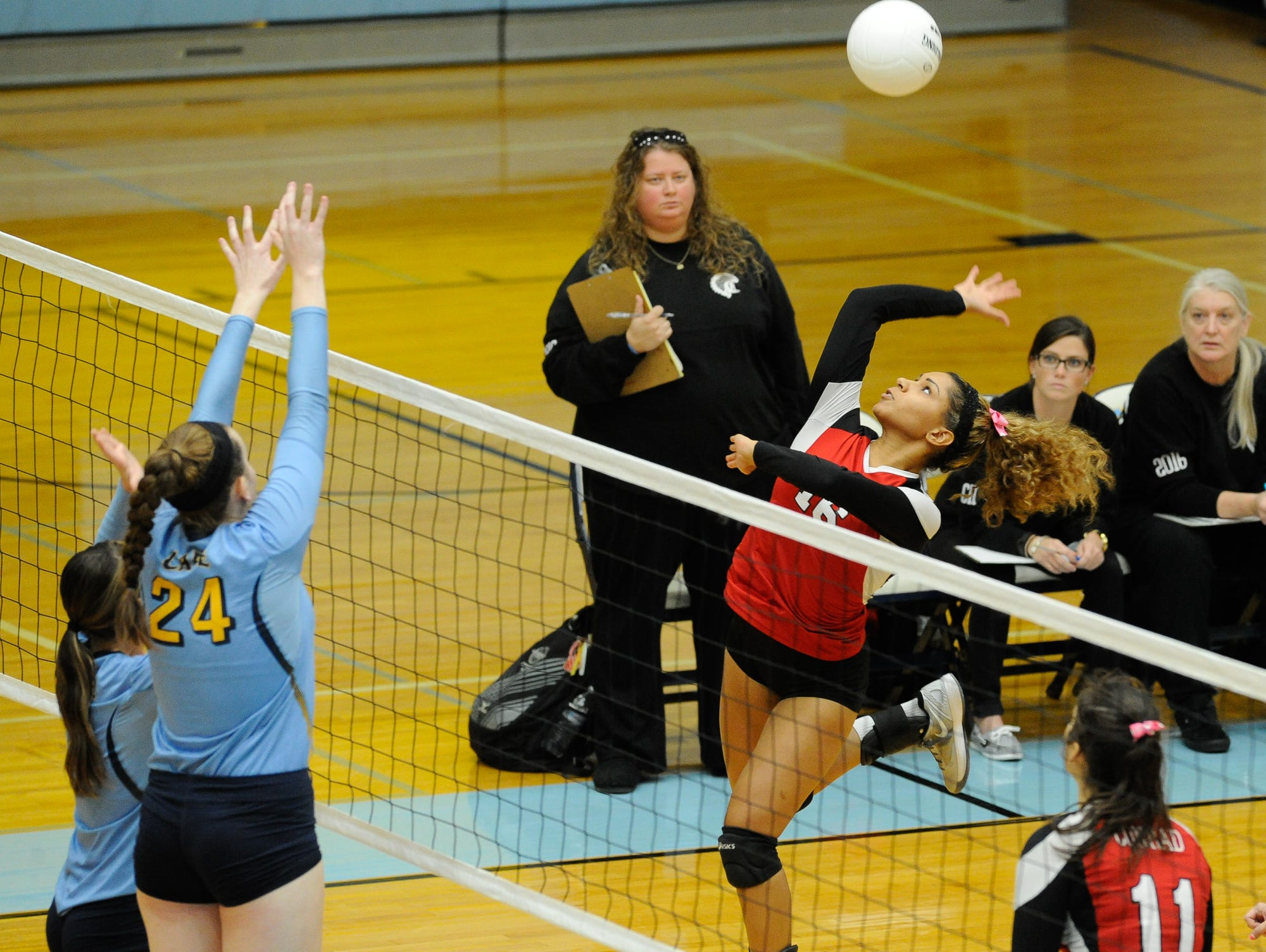 Conrad's #16 Aspen Morehead with a spike in the first game against Cape Thursday night at Cape Henlopen High School.
