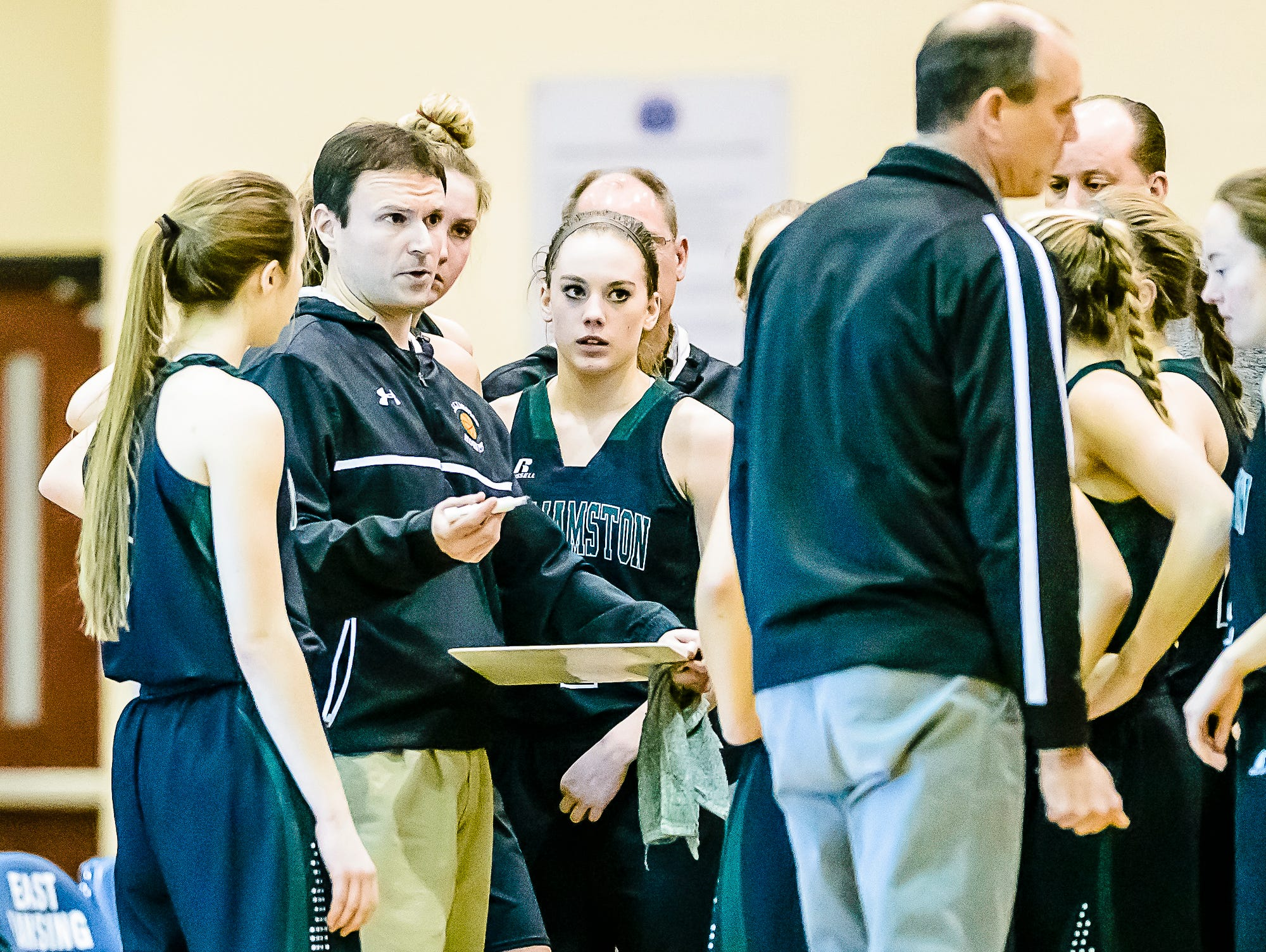 Williamston coach Pete Cool ,left, speaks to his team in a timeout during a game last month. The Williamston girls basketball program has had a consistent amount of success under Cool over the last several seasons.