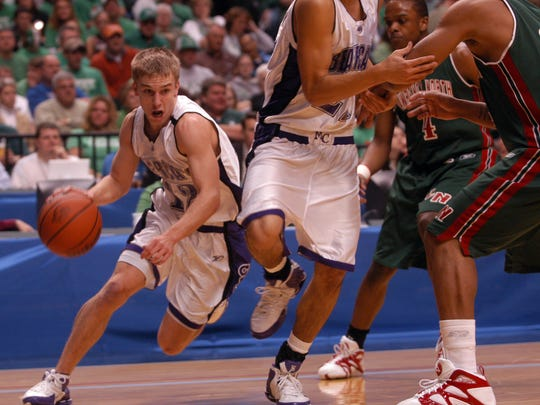 In this 2006 file photo, Muncie Central's Ben Botts drives the lane in the state championship game against Lawrence North.
