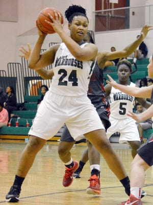 Peabody's Demetrion Jones (24) looks for an open teammate during Thursday night's playoff game. Jones scored 14 points as the Lady Warhorses defeated Assumption, 82-67.