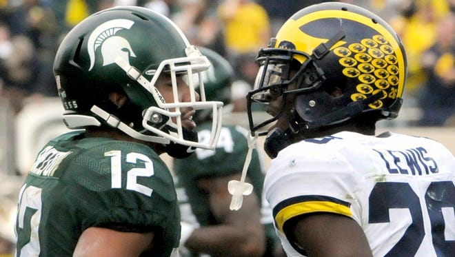 Michigan State University  senior receiver R.J. Shelton (12) and Michigan's Jourdan Lewis exchange words after a play during the second half of the Michigan State vs. Michigan Big Ten football game Saturday, Oct. 29, 2016 at Spartan Stadium in East Lansing.