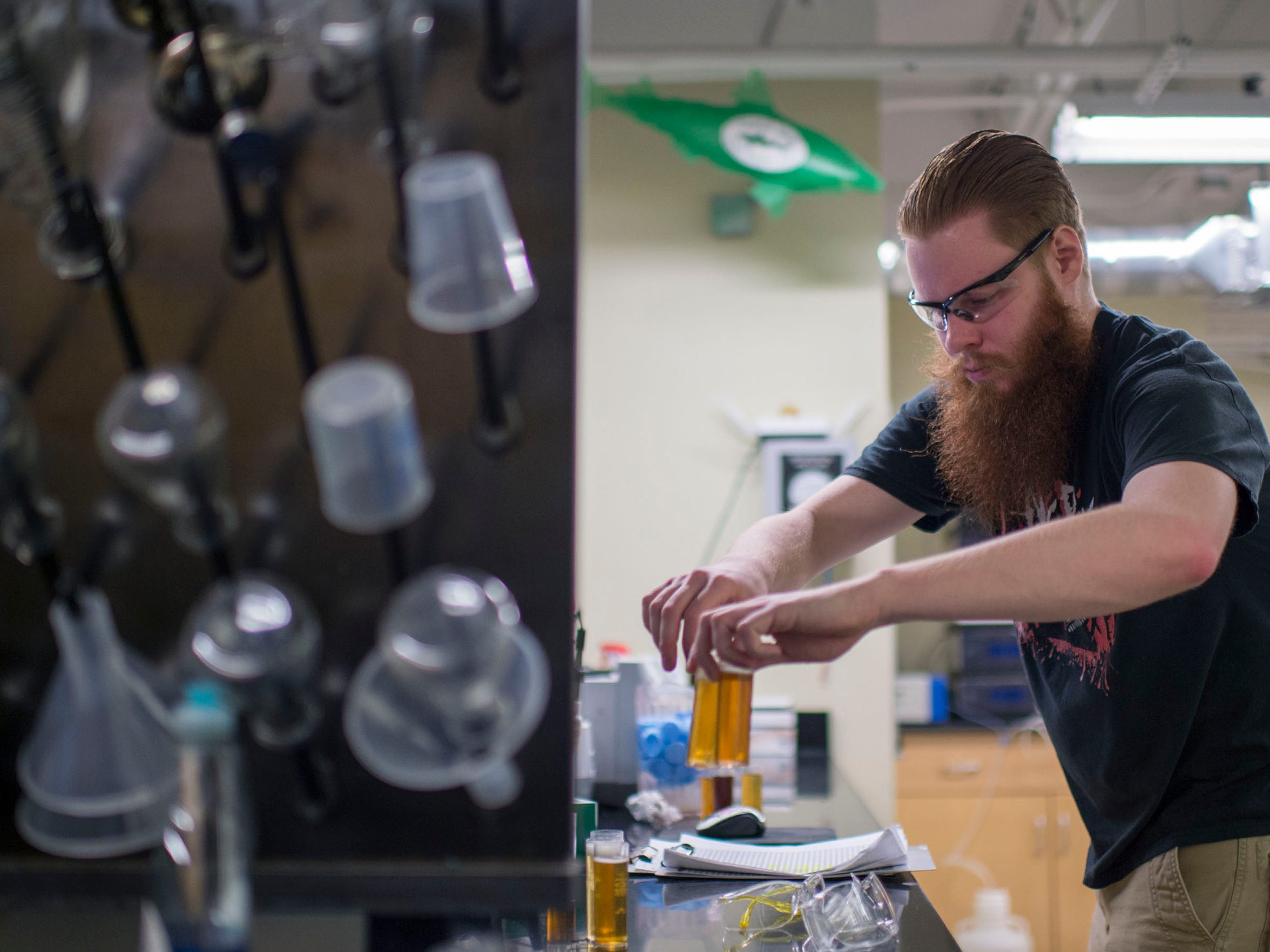 Process chemist Sean Miller checks the gravity of alcohol in the brewery's lab Wednesday, Feb. 11 at Dogfish Head in Milton.