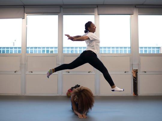 Freshman Naisha DeLacruz performs a move over dance