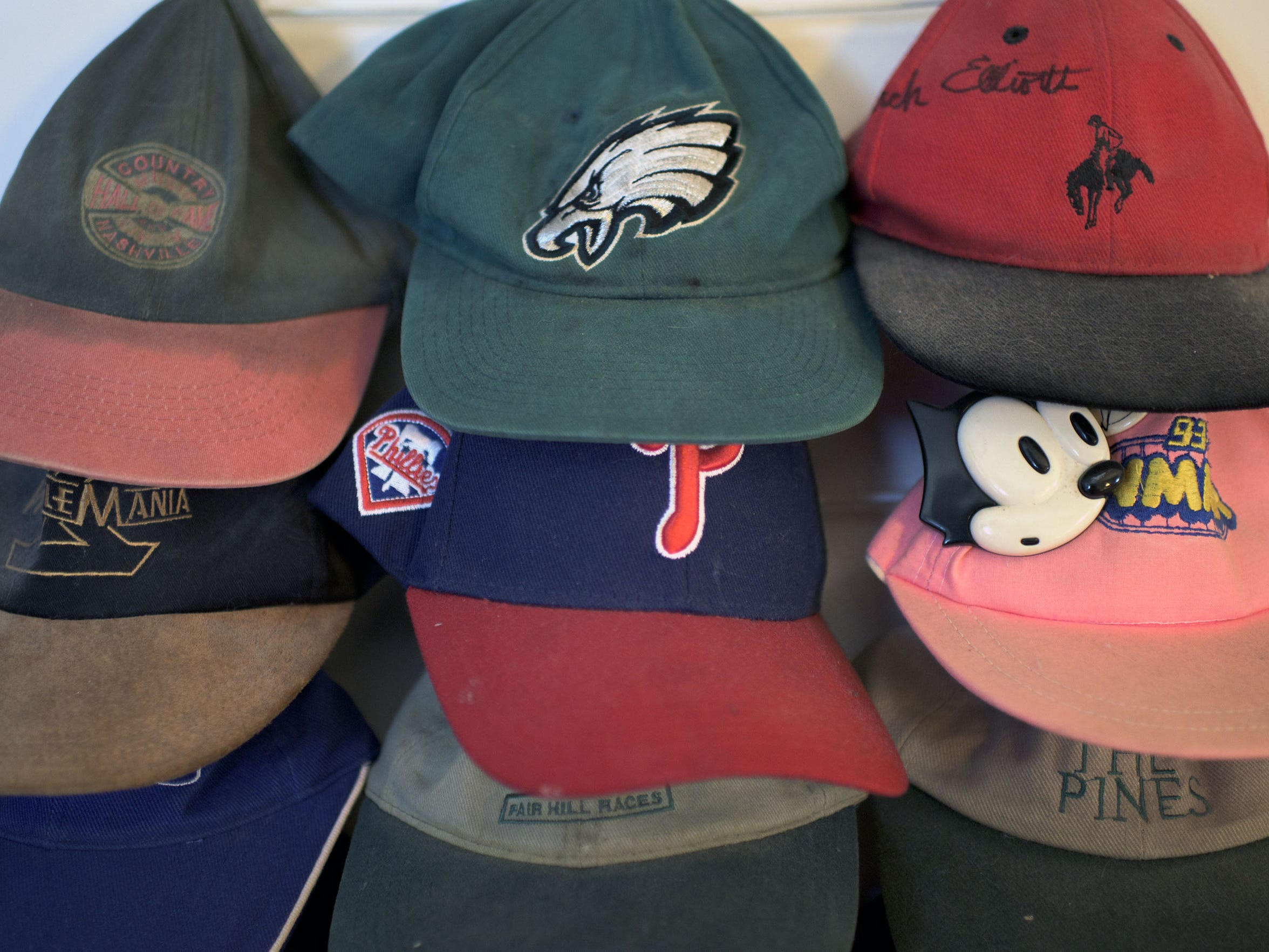Various hats Michael Tearson has collected over the years.