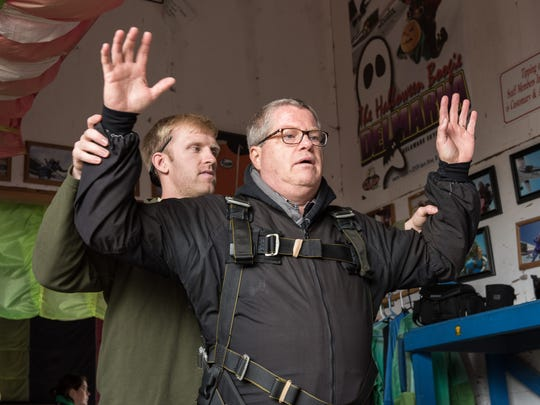 Skydiving instructor Andy Bean, left, give Tim Hill a few pre-flight instructions just before a jump at Laurel Airport.